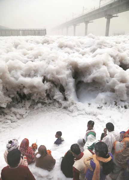 People celevrating Chatth puja at Yamuna near kalindi Kunj, The Yamuna is pollutesd toa the level of surf and the people is already suffering with the air pollution. Express Photo by Abhinav Saha. November 11, 2016.